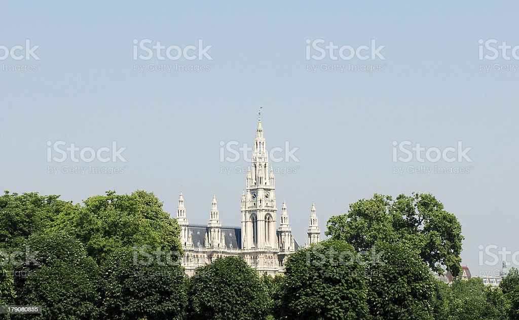 Vienna City Hall beyond the trees in Heldenplatz, Austria royalty-free stock photo