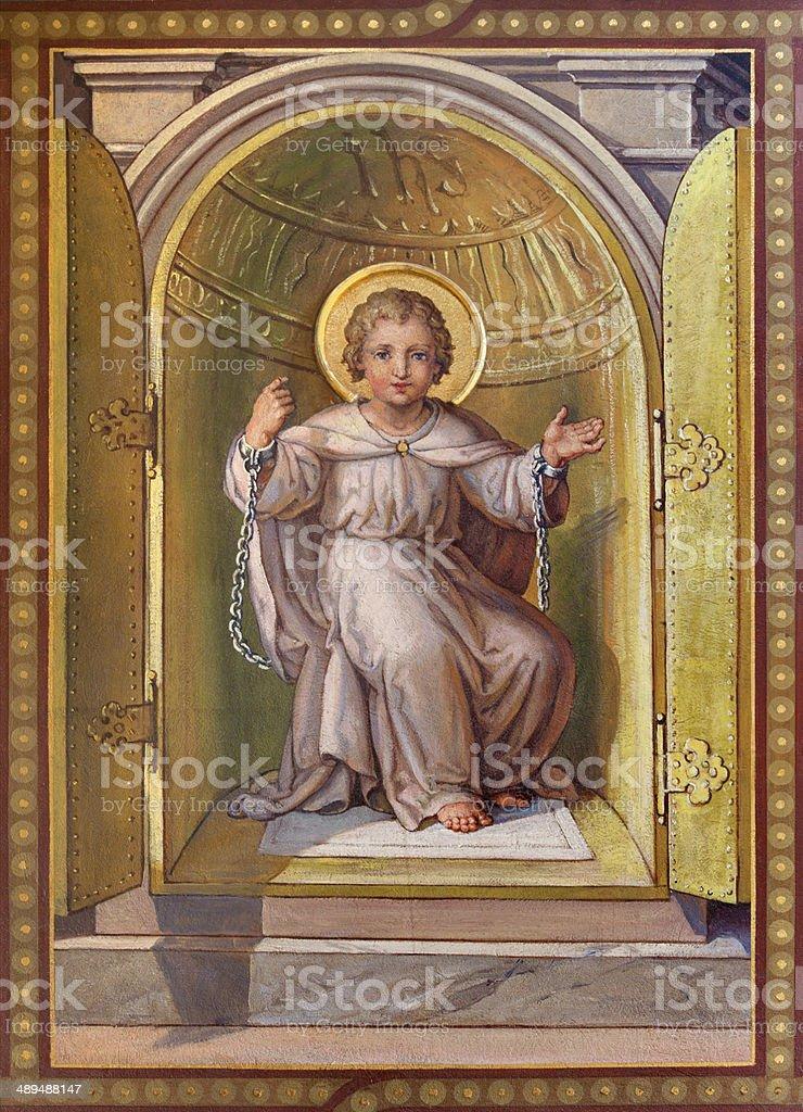 Vienna - symbolic fresco of little Jesus in tabernacle stock photo