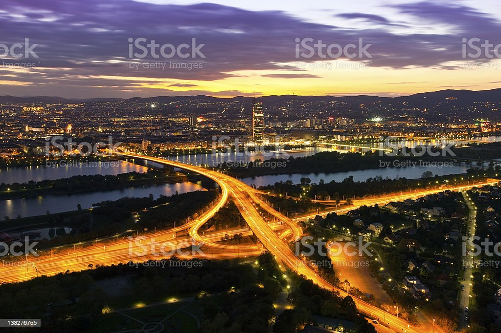 Vienna with Danube River & Island (Donauinsel), highway at night stock photo