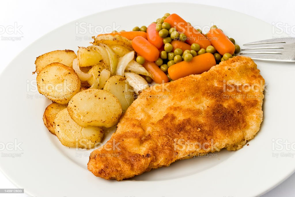 Viennese Schnitzel  with fried potatoes royalty-free stock photo