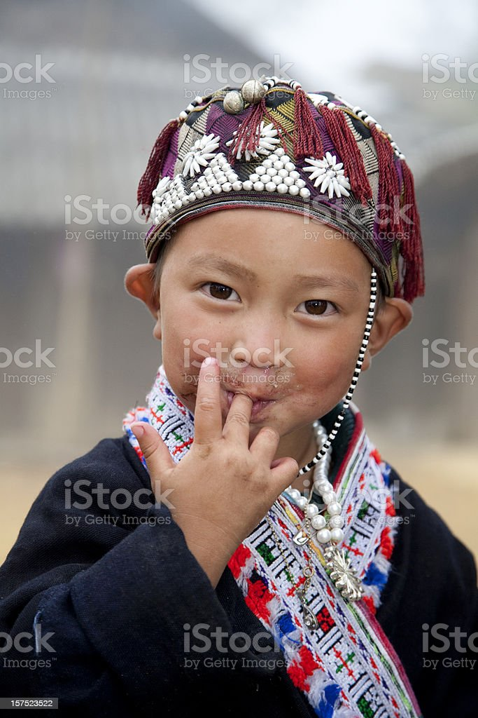 Vietnam, boy playing near Sapa. stock photo