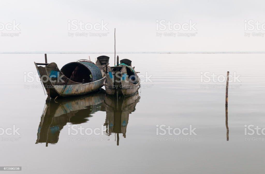 Vietnam Fishing Boats in the Fog stock photo