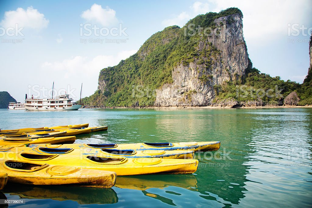 Vietnam Halong Bay parked kayaks on a sunny day stock photo