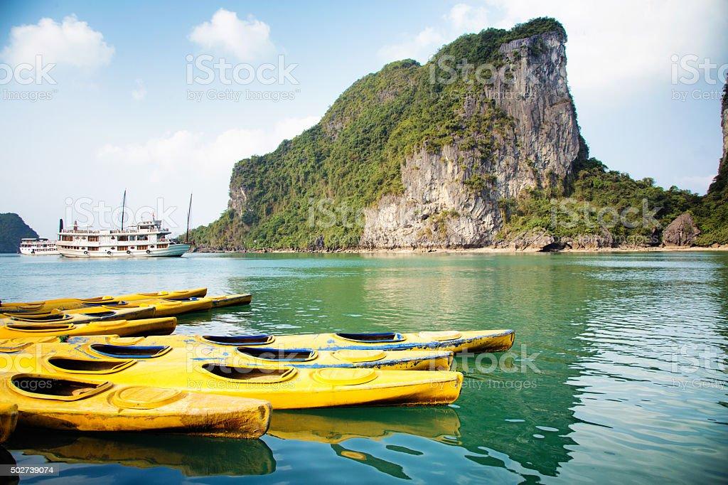Vietnam Halong Bay parked kayaks on a sunny day stock photo