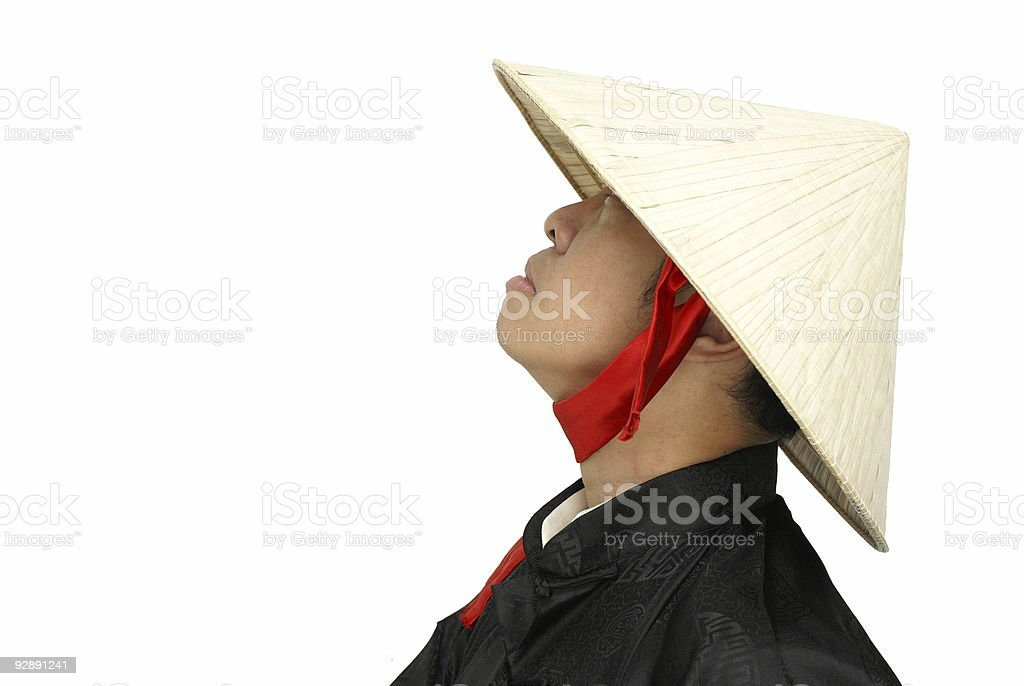 Vietnam man with hat looking up royalty-free stock photo