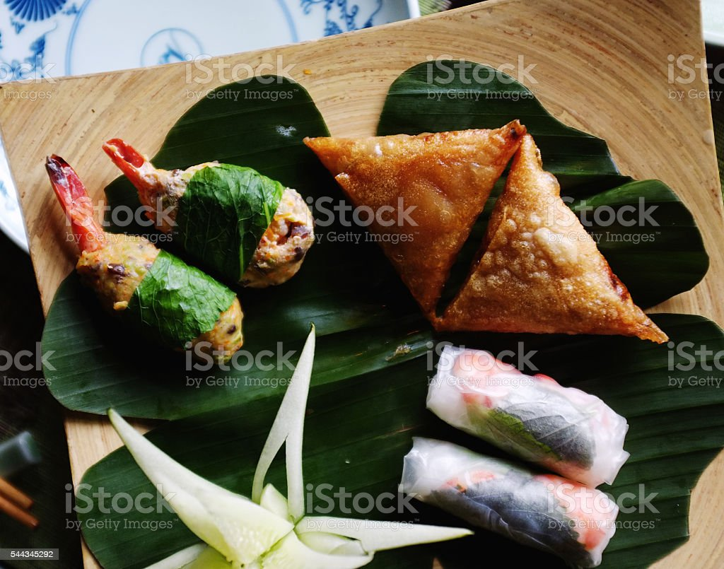 vietnam spring rolls and samosas stock photo