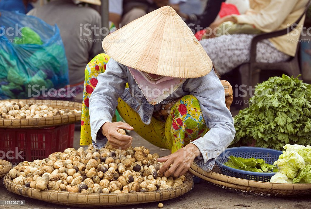 vietnam street market lady seller ho chi minh saigon stock photo