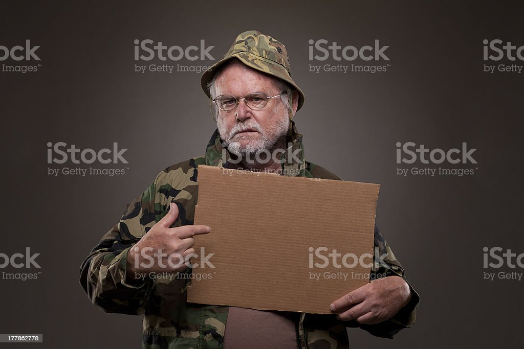 Vietnam Veteran showing a cardboard piece royalty-free stock photo