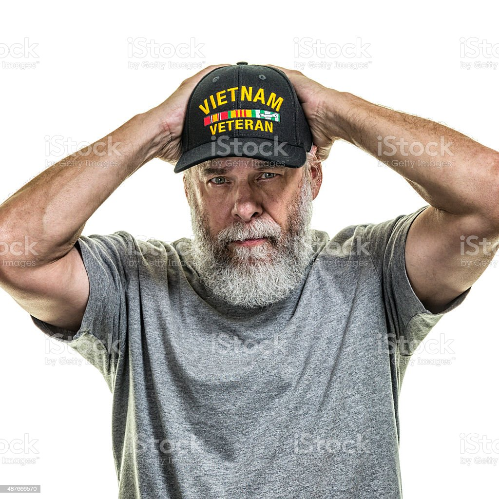 US Vietnam War Senior Adult Man Military Veteran Holding Hat stock photo