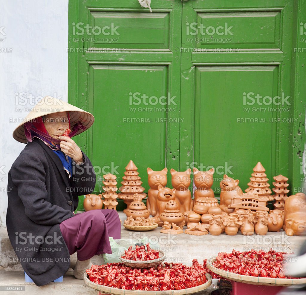 Vietnamee woman selling ocarinas in Hoi An, Vietnam. stock photo