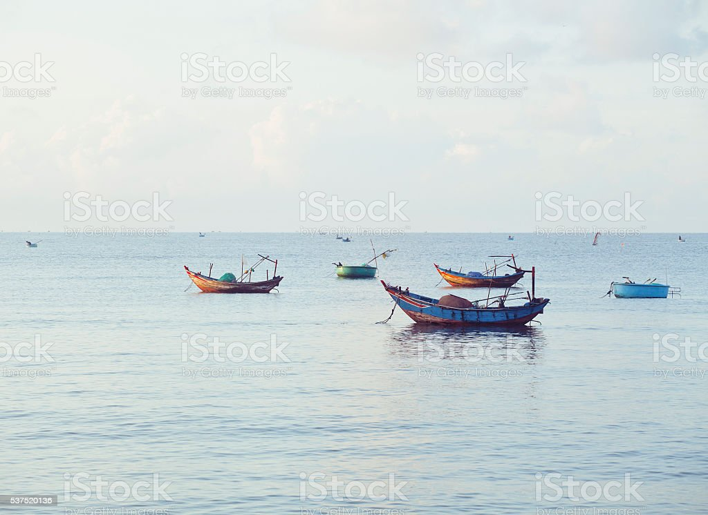 vietnameese national boats in sea at sunrise stock photo