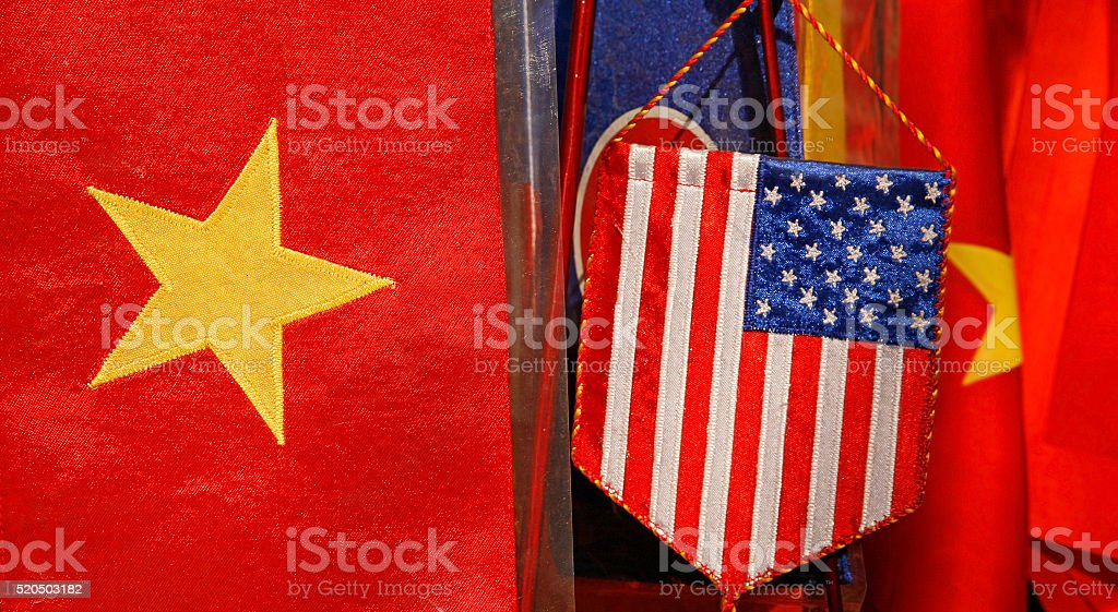 Vietnamese and United States national flags side-by-side. stock photo