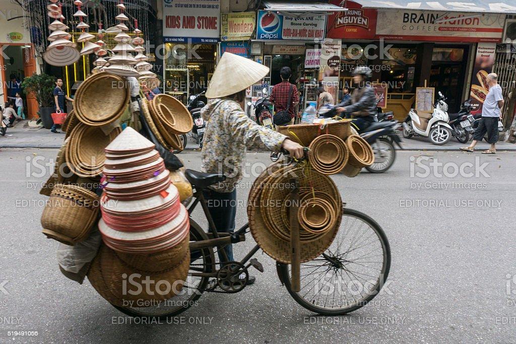 Vietnamese bike street trader stock photo