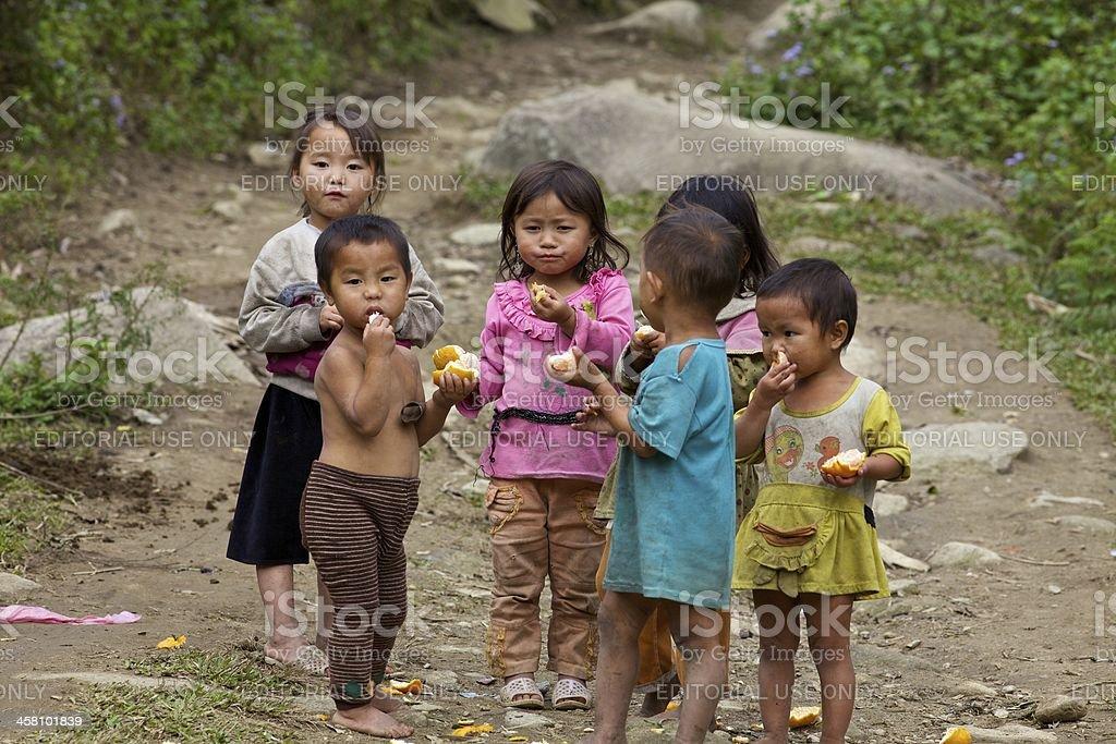 Vietnamese Children Eating on Trail stock photo