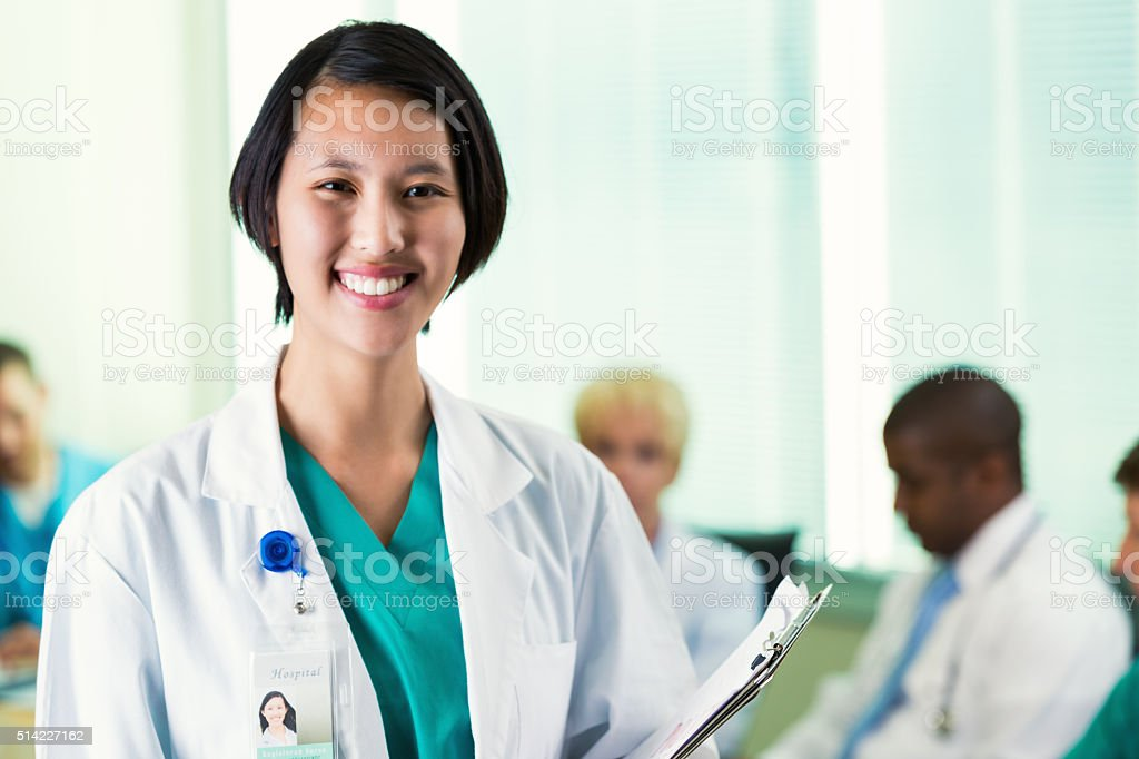 Vietnamese doctor in hospital staff meeting stock photo