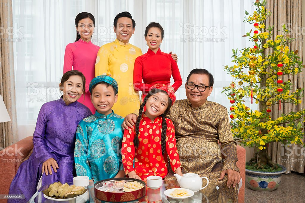 Vietnamese family in national costumes stock photo