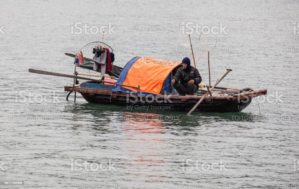 Vietnamese fisherman pulling out net stock photo