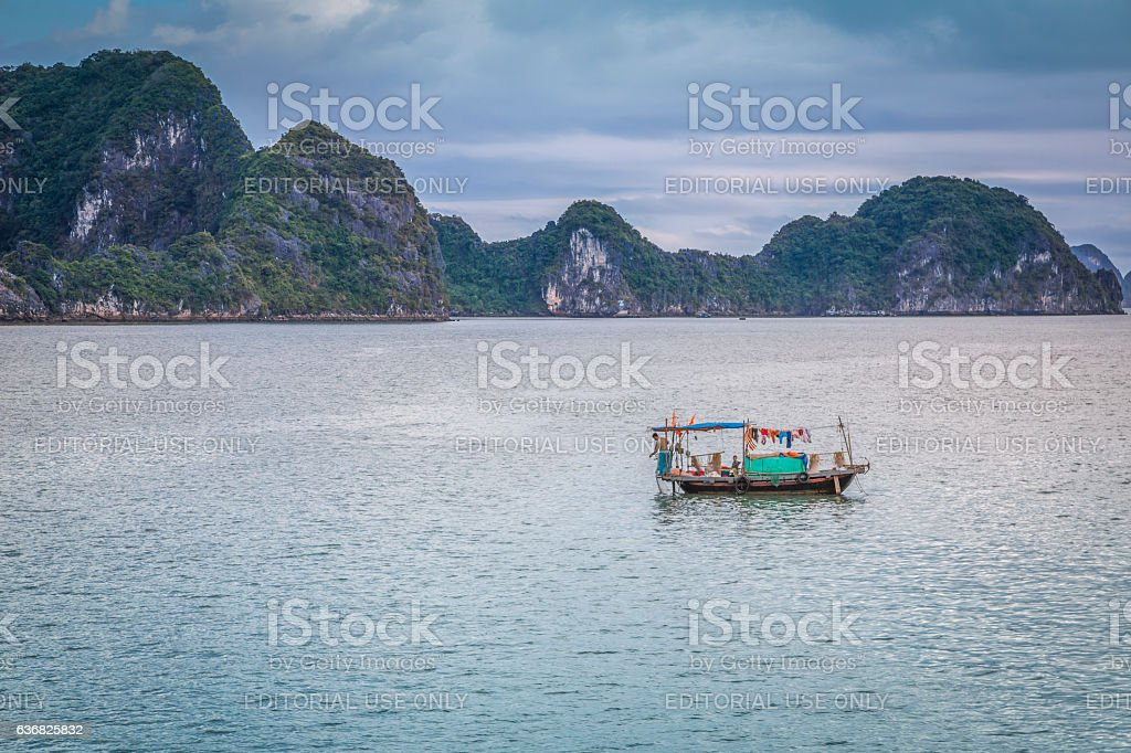 Vietnamese fishing boat on Halong Bay stock photo