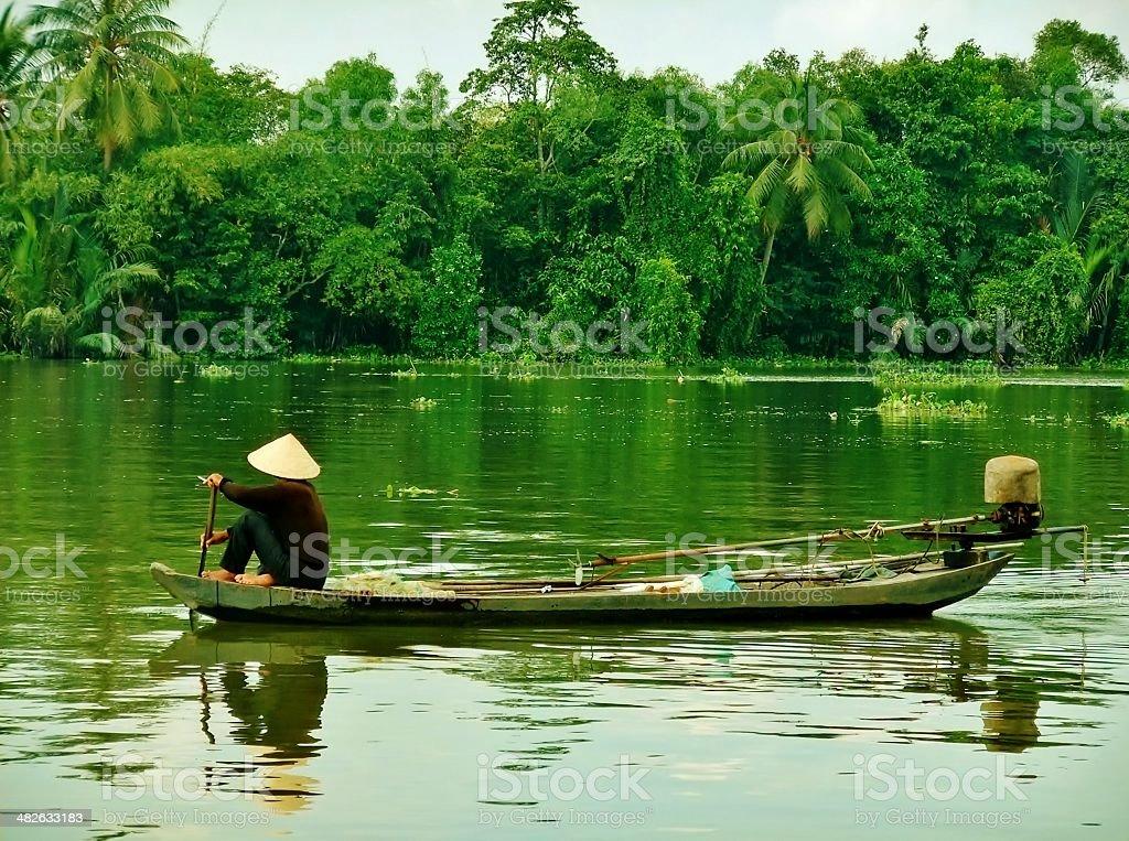 Vietnamese fishing boat on river stock photo