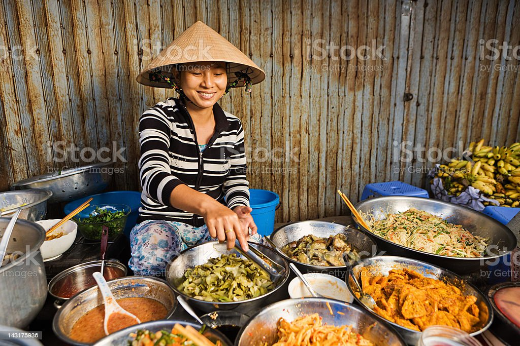 Vietnamese food vendor on local market stock photo