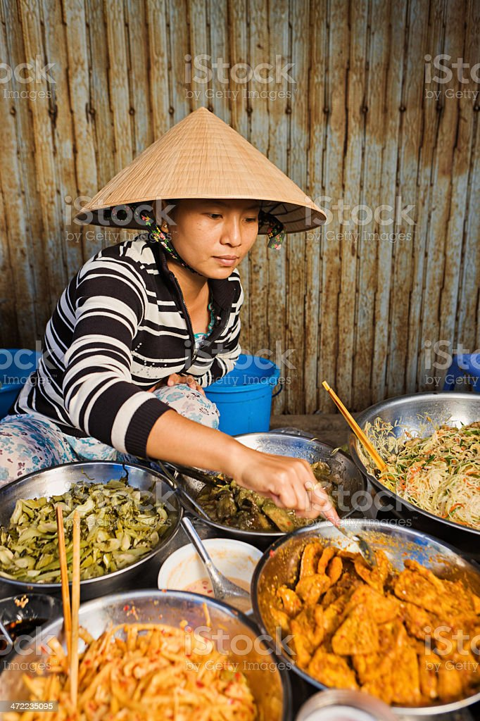 Vietnamese food vendor on local market royalty-free stock photo