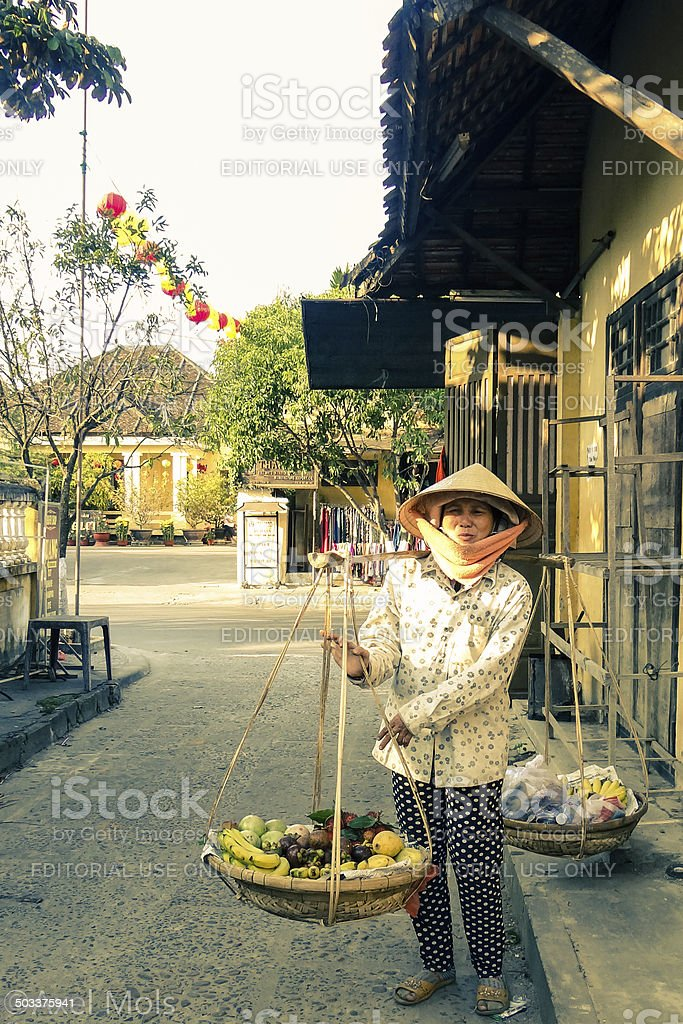 Vietnamese fruit seller in Hoi An's 'Old Town' stock photo