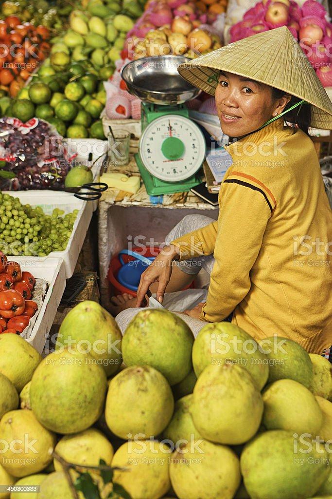 Vietnamese fruit seller royalty-free stock photo