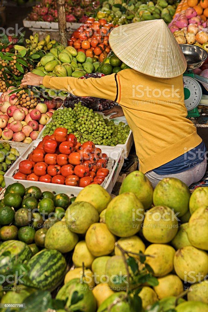 Vietnamese fruit seller stock photo