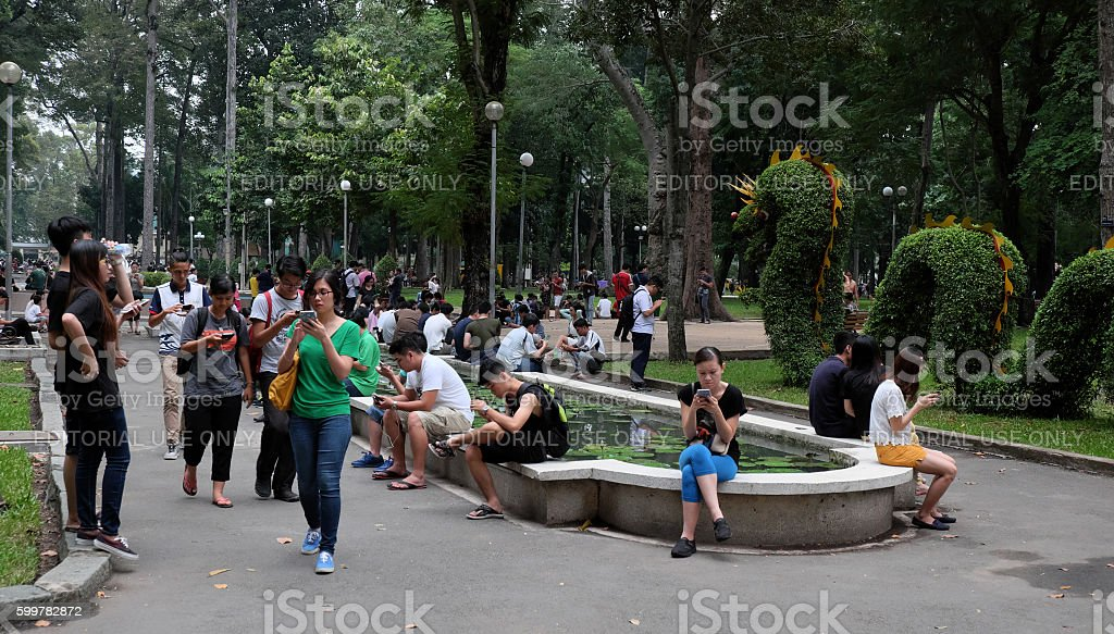 Vietnamese gamer play Pokemon go game stock photo