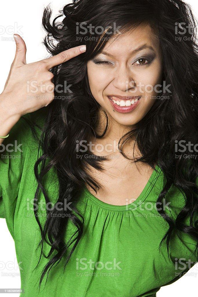 Vietnamese Girl Points Finger at Head stock photo