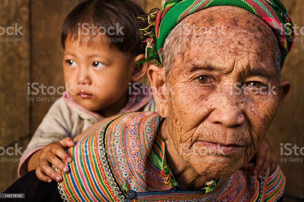 Vietnamese grandmother from Flower Hmong Tribe with her granddaughter royalty-free stock photo