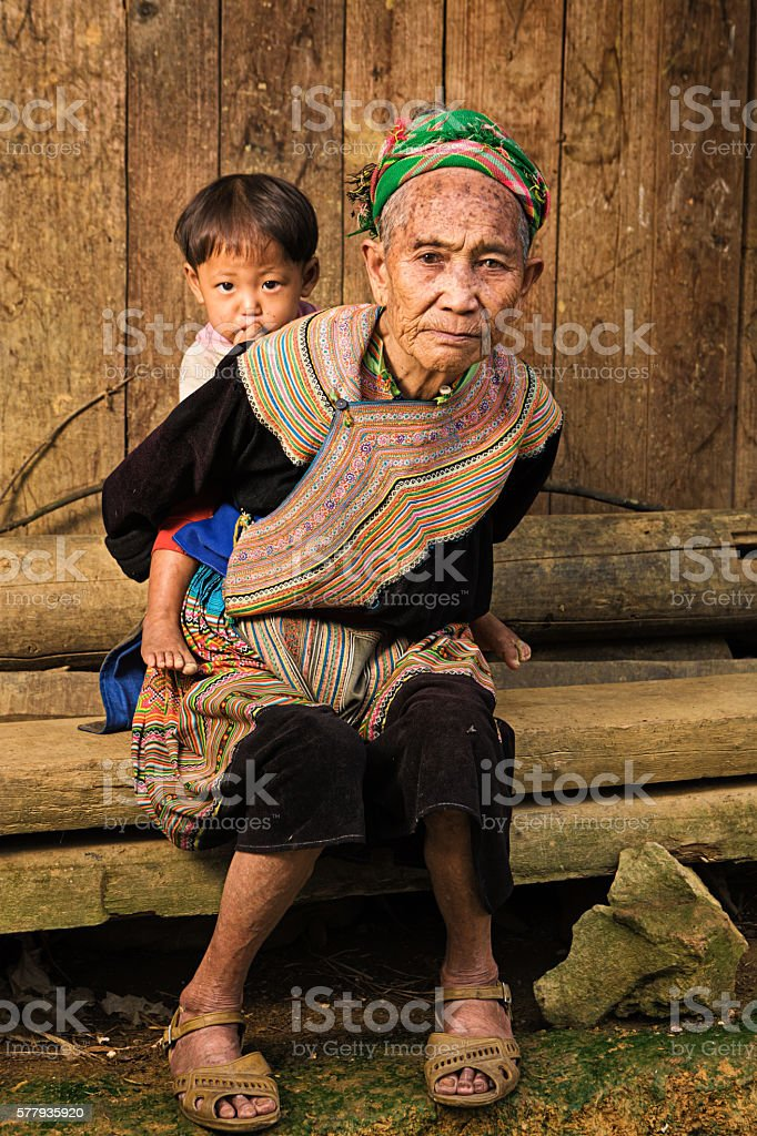 Vietnamese grandmother from Flower Hmong Tribe with her granddaughter stock photo