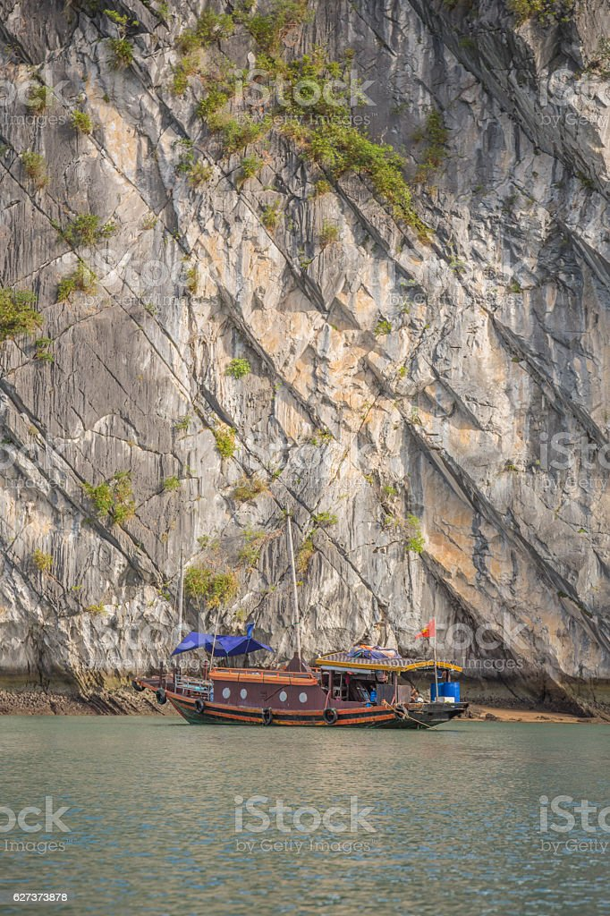 Vietnamese Junk cruising on Halong Bay, Hanoi, Vietnam stock photo