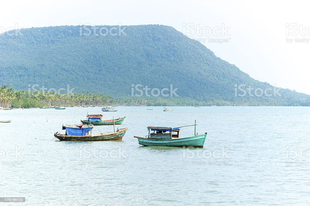 Vietnamese little fishing boats on the ocean royalty-free stock photo