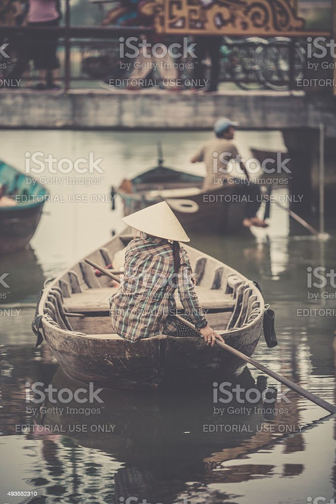 Vietnamese Man Wearing Traditional Hat on Boat stock photo
