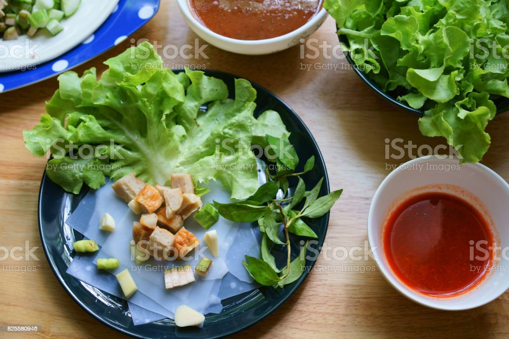 Vietnamese Meatball Wraps with rice paper rolls with vegetable on the dark dish stock photo