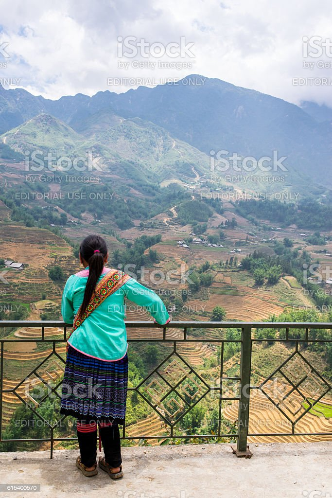 Vietnamese minority guide admiring the landscape with mountains stock photo