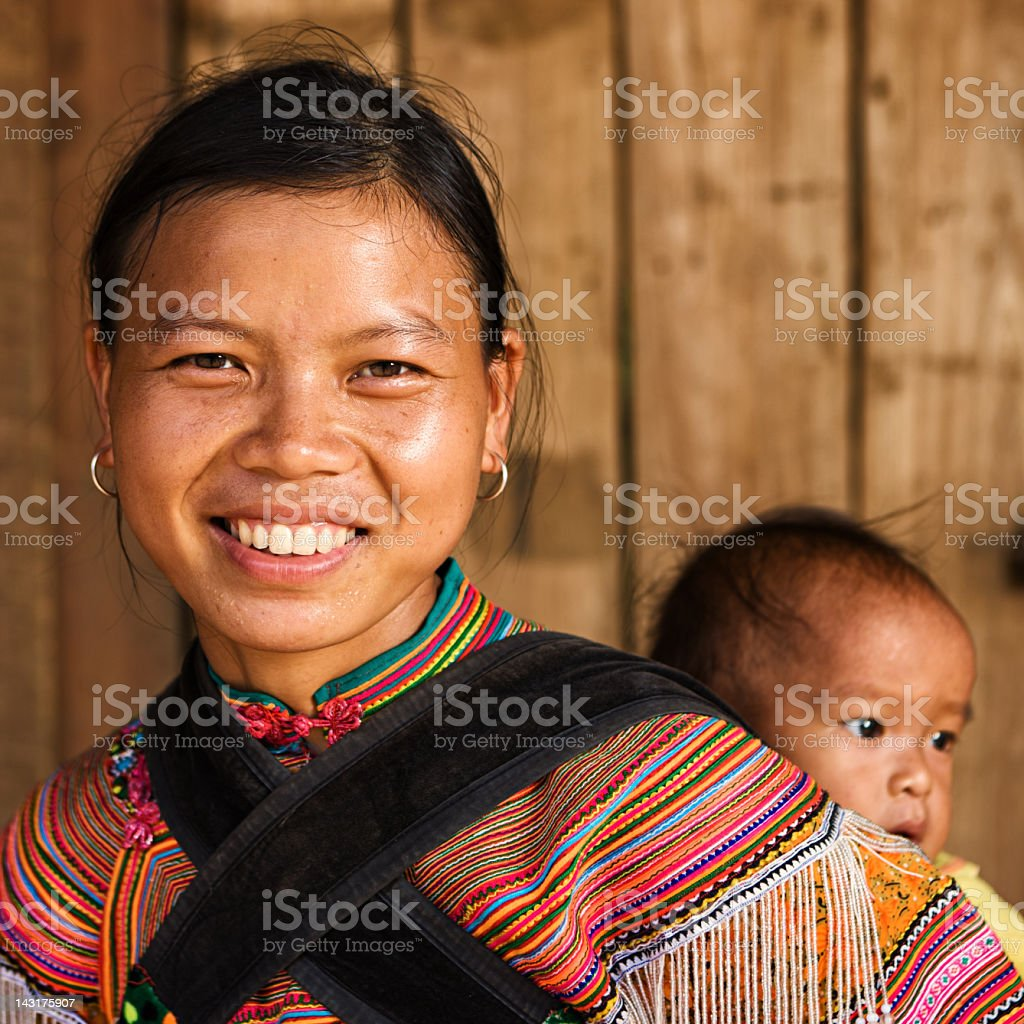 Vietnamese mother from Flower Hmong Tribe with her baby royalty-free stock photo
