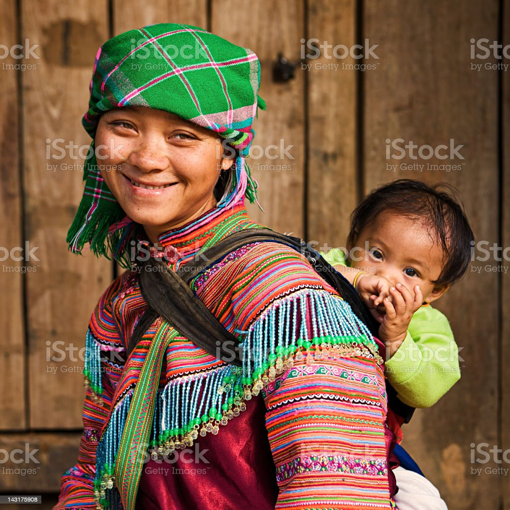 Vietnamese mother from Flower Hmong Tribe with her baby stock photo