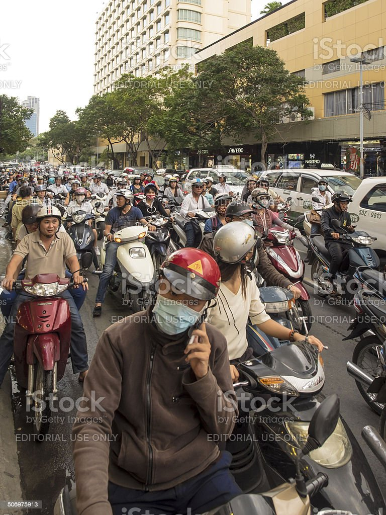 Vietnamese motorcyclists waiting in traffic royalty-free stock photo