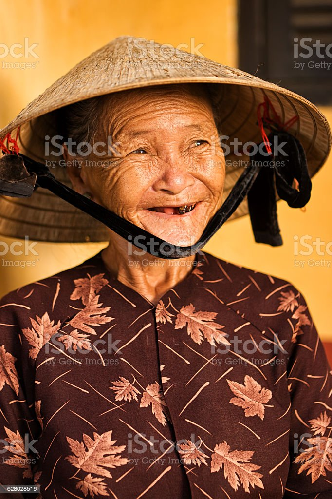 Vietnamese old woman, Hoi An stock photo
