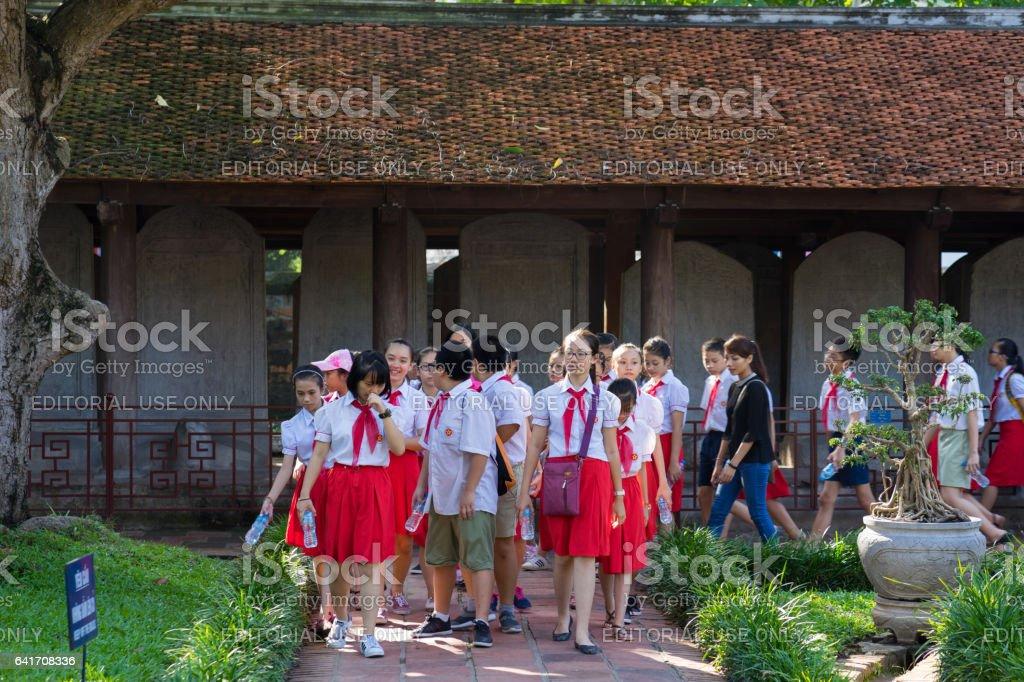 Hanoi, Vietnam - July 24, 2016: Vietnamese pupils visit Temple of Literature ( Van Mieu ), the first national university in Hanoi, Vietnam stock photo