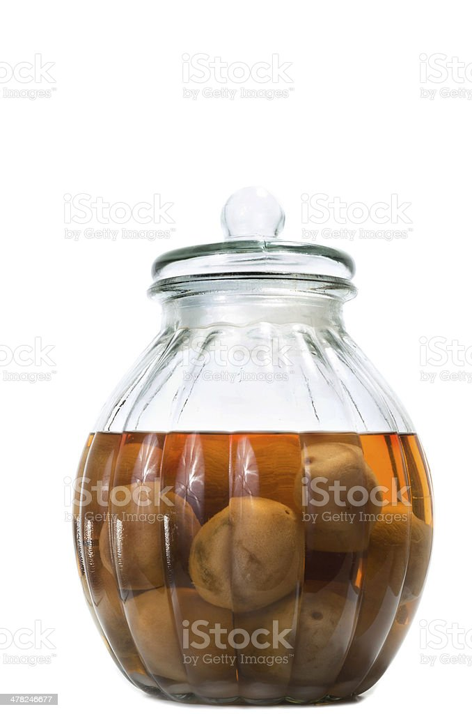 Vietnamese salted and pickled limes in a glass jar stock photo