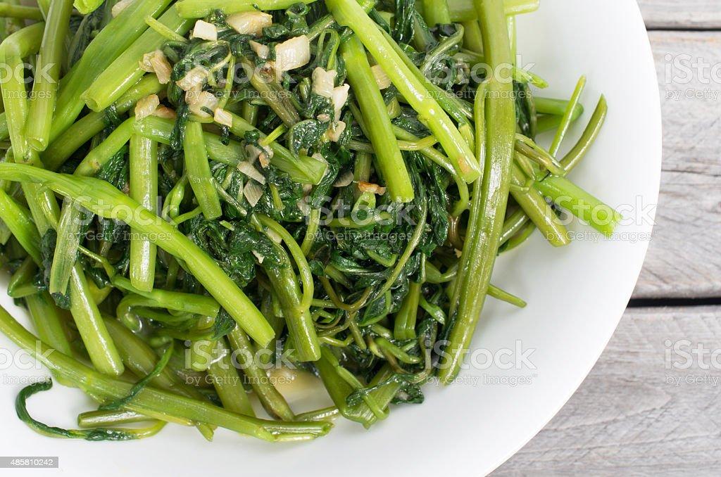 Vietnamese stir fried morning glory vegetable stock photo
