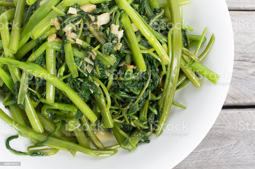 Vietnamese stir fried morning glory vegetable stock photo
