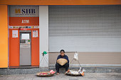 Vietnamese vendor sitting in front of SHB commercial bank