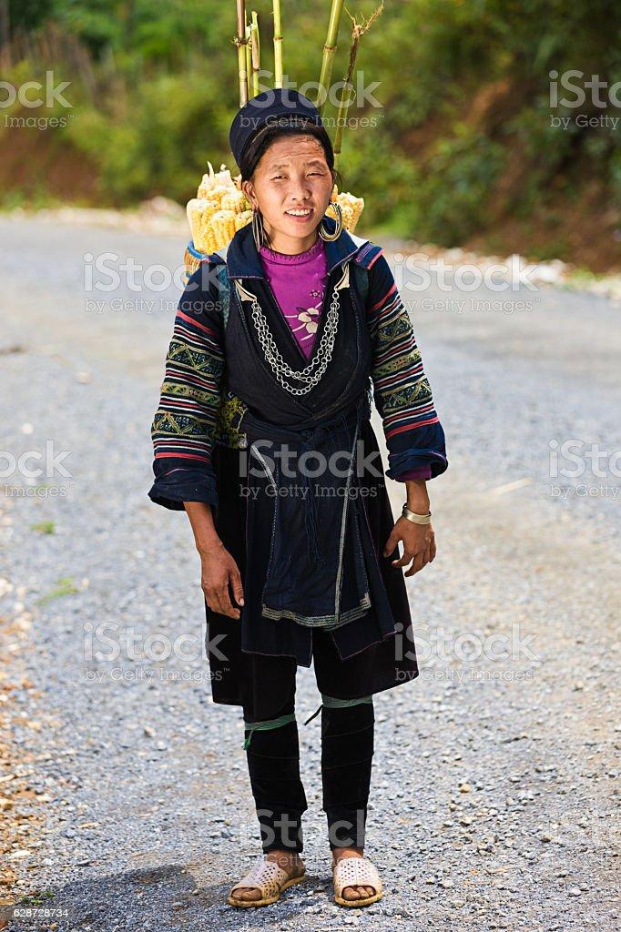 Vietnamese woman carrying corn near Sapa town stock photo