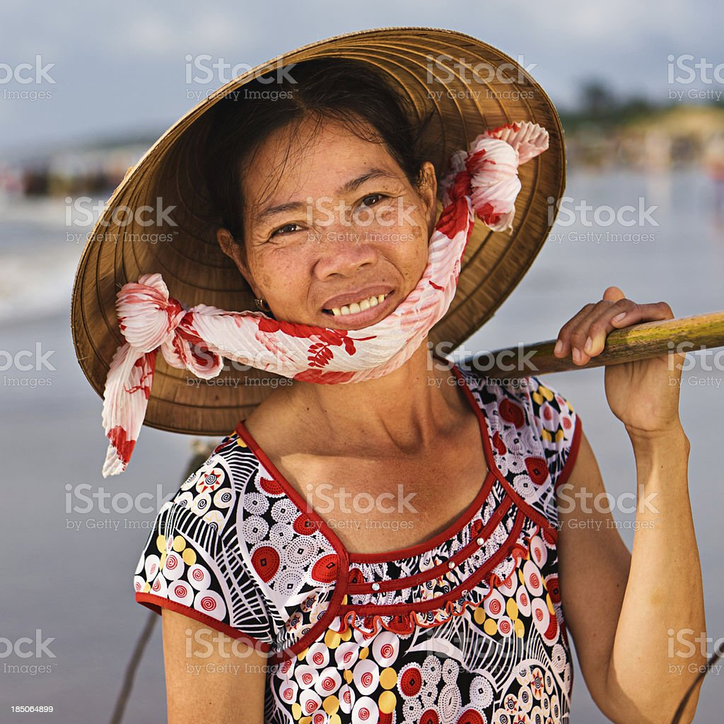 Vietnamese woman carrying fresh fishes stock photo