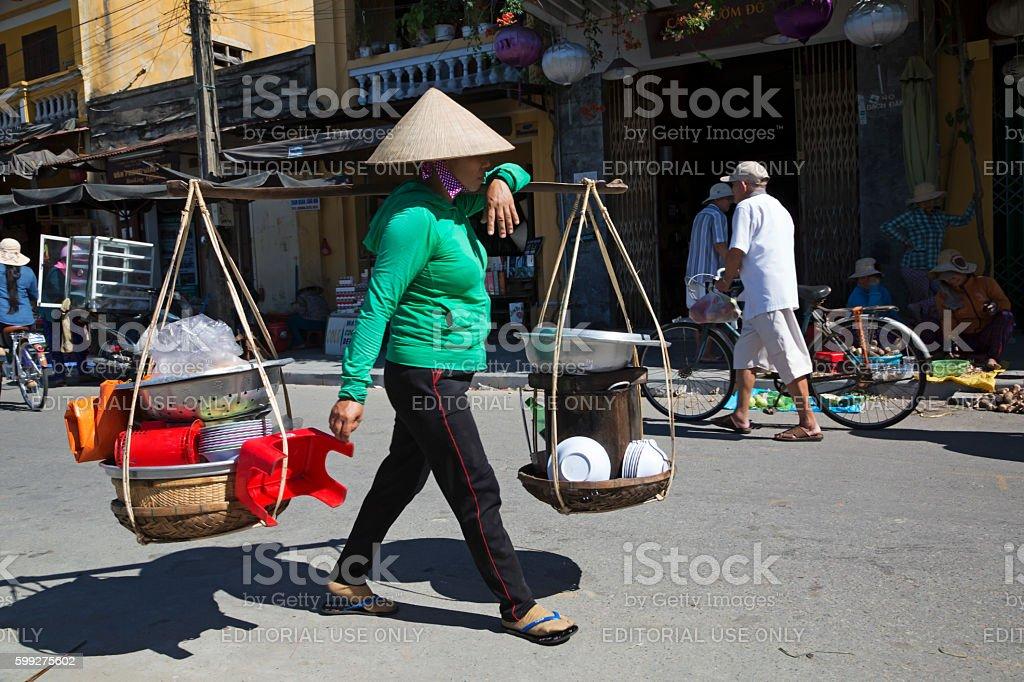 Vietnamese woman carrying goods stock photo