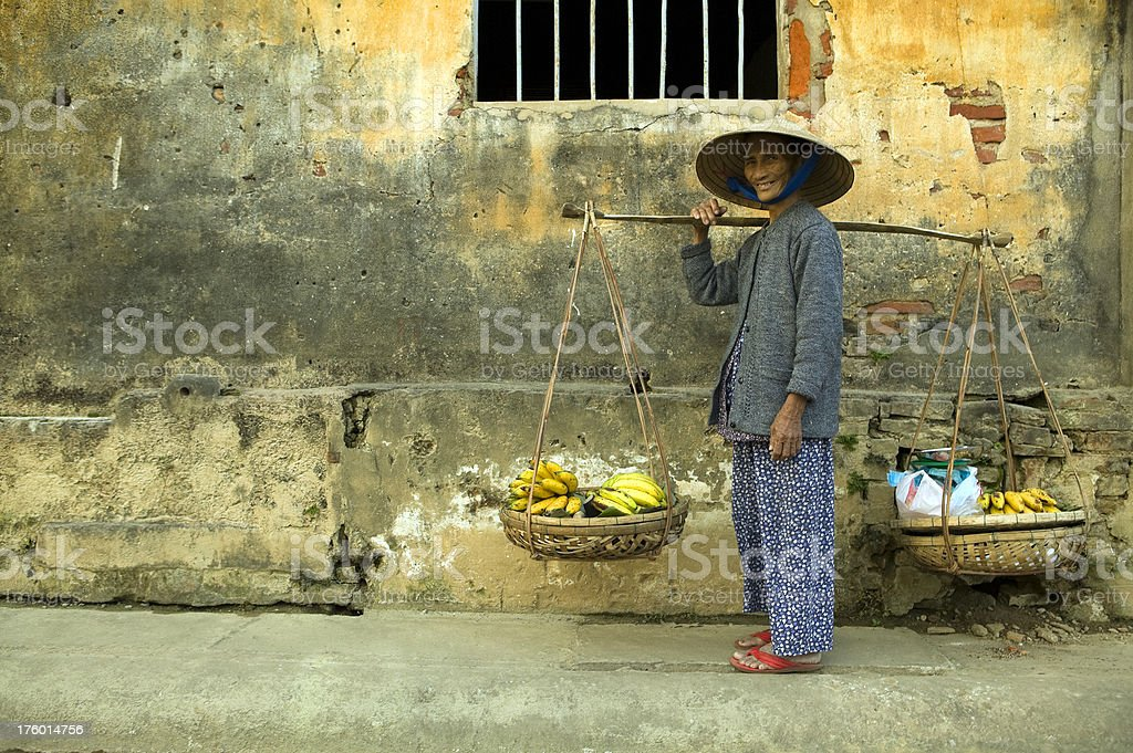 vietnamese woman copy space yellow wall royalty-free stock photo